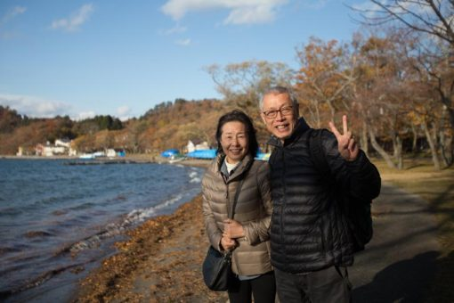 Japanese couple traveling through Japan