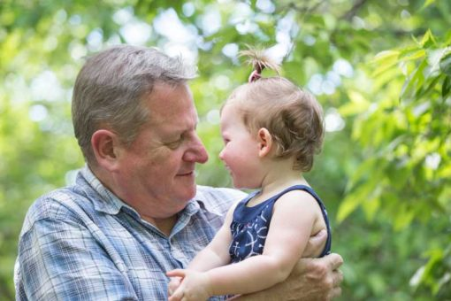 Grandad looking at his one year old granddaughter ©Erika's Way Photography