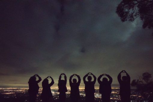 hands in the air to form hearts while looking at the City of Melbourne ©Erika's Way Photography