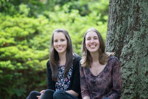 two sisters smiling at the camera in the Dandenong Ranges, Melbourne ©Erika's Way Photography