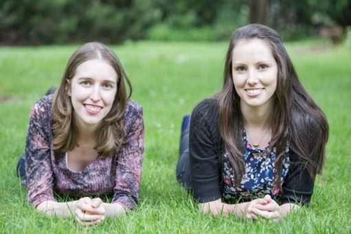 two beautiful sisters smiling: Family photography in the Dandenong Ranges ©Erika's Way Photography