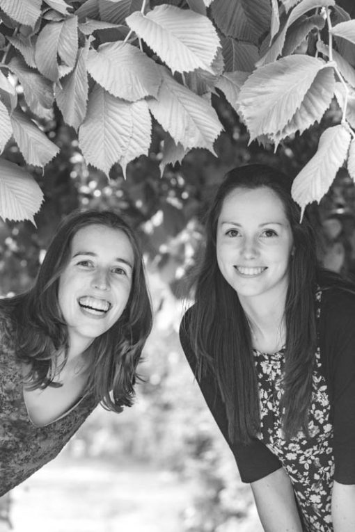 laughing and smiling under a tree ©Erika's Way Photography