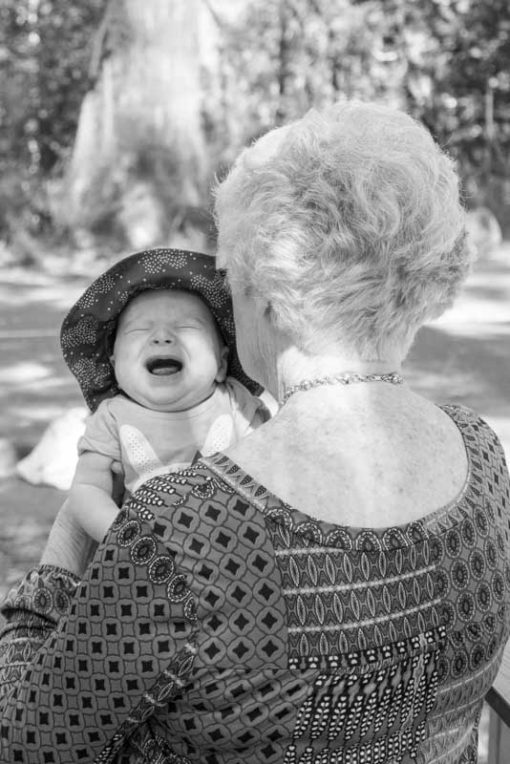 Crying baby calming down in her great grandmother's arms, family Photography in the Dandenong Ranges by Erika's Way Photographer