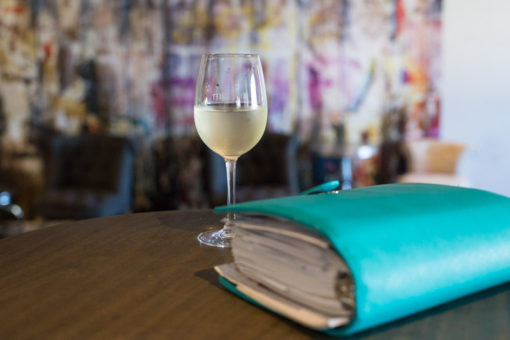 Getting ready for the meeting with agenda and a glass of white wine. ©Erika's Way Photography