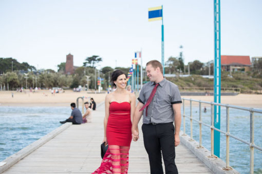 Engaged couple photo shooting in Frankston, Vic. Couple walking along the Pier at Frankston beach. Copyright Erika's Way Photography