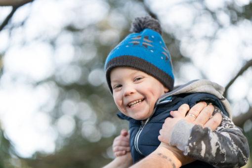kid having fun on his Dad's shoulders