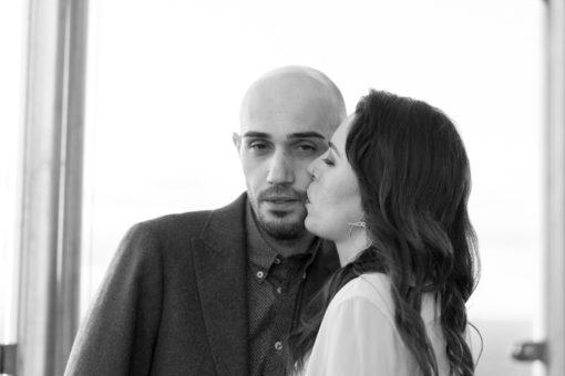 Bride sweetly kissing her groom on the cheek