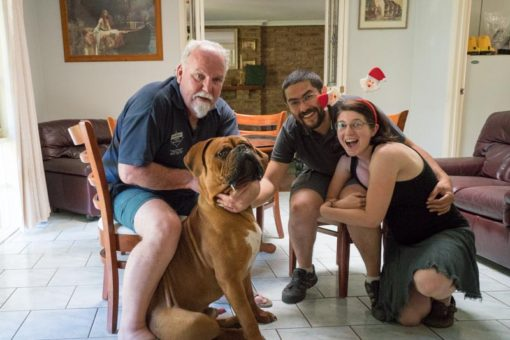 self portrait at Christmas with a couple and their neighbour and his dog