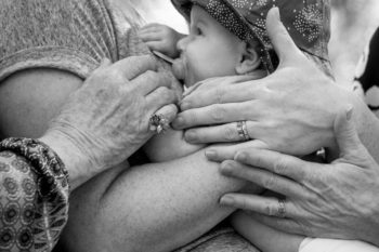 Four generations of girls holding hands copyright Erika's Way Photography