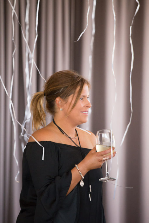 Guest with champagne and flying helium balloons at the Engagement Party at Daveys Hotel, Frankston, Vic. Copyright Erika's Way Photography