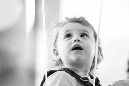 Baby girl looking up at the helium balloons at an Engagement Party at Daveys Hotel in Frankston, Vic, in the Mornington Peninsula. Copyright Erika's Way Photography