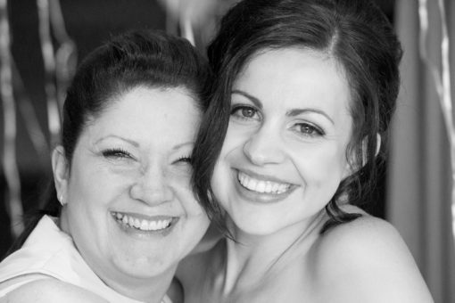 Mum and Bride at the Engagement Party smiling and laughing at the camera. Copyright Erika's Way Photography