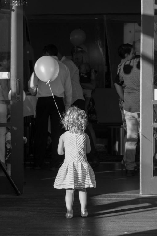 Girl playing with a helium balloon. Copyright Erika's Way Photography