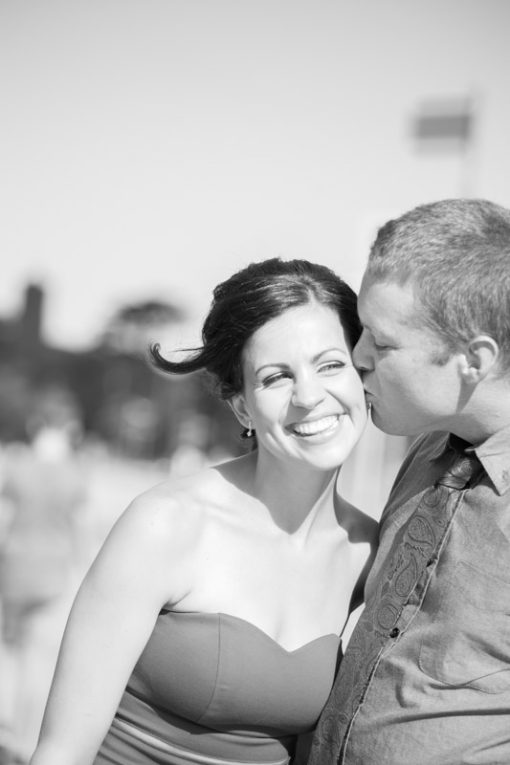 Groom kissing the bride in Frankston for a couple photo shooting session. Copyright Erika's Way Photography