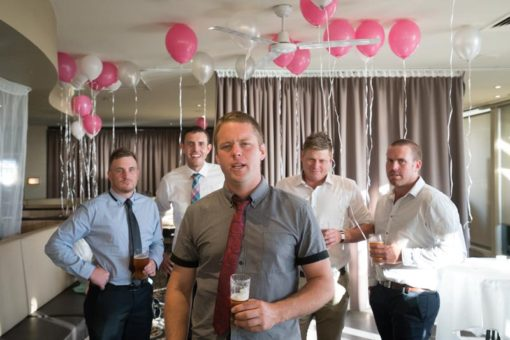 Groom and his Groomsmen with pink and white helium balloons. Copyright Erika's Way Photography