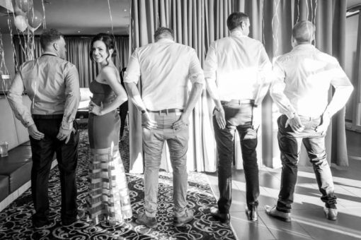 Bride and Groomsmen in funny poses. Copyright Erika's Way Photography Wedding and Engagement Photographer