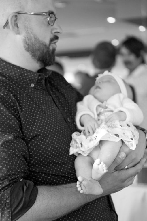 Dad and his 6 weeks old baby girl in his arms