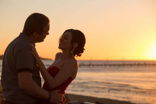 Bride and Groom silhouette in the sunset at the beach in Frankston. Copyright Erika's Way Photography Wedding and Engagement Photographer