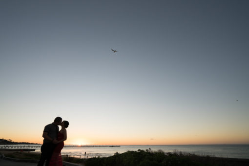 Silhouette of two lovers in the sunset at Frankston beach. Copyright Erika's Way Photography Wedding and Engagement Photographer