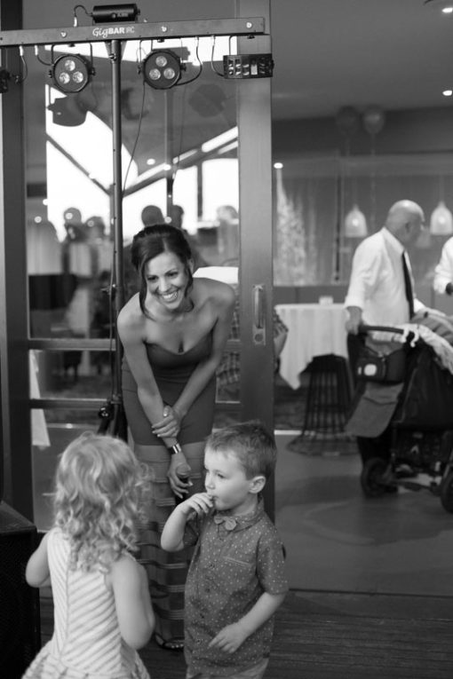 Bride talking and playing with the kids at the Engagement Party at Daveys Hotel in Frankston