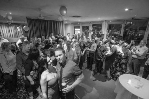 Engagement Party group photo with more than 80 people. Copyright Erika's Way Photography at Daveys Hotel in Frankston, Vic