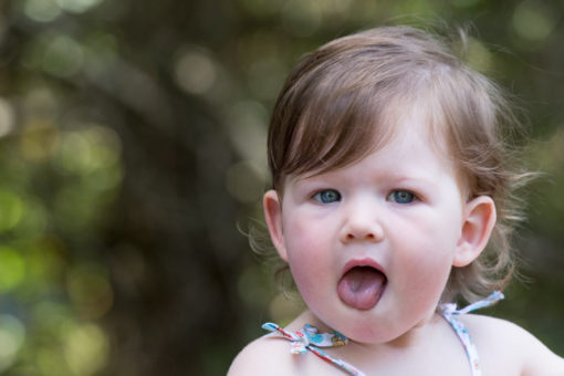 Baby girl showing her tongue. ©Erika's Way Photography