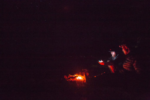 camp fire under the starry night photo by Erika's Way Photography