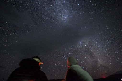 two backpakers under the starry night in Tasmania photo by Erika's Way Photography