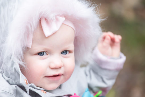 Little girl in a fluffy coat by Erika's Way Photography