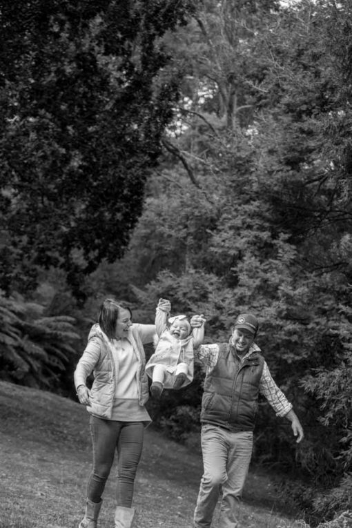 Mum and Dad and baby daughter playing in the park. Copyright Erika's Way Photography