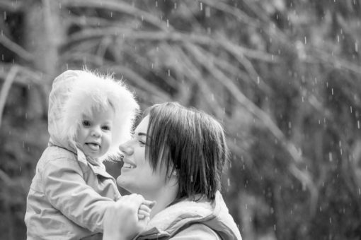 Mum and Daughter playing in the rain at Emerald Lake Park, Emerald, Vic. Copyright Erika's Way Photography
