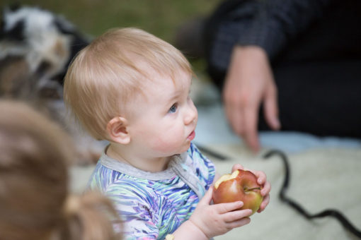 Baby Emmeline eating an apple