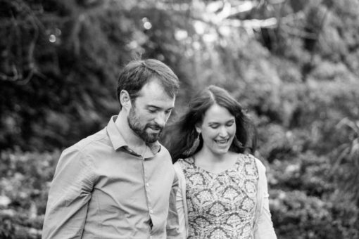 Husband and Wife holding hands and playing with their beautiful children. Photo by Erika's Way Photography Photographer