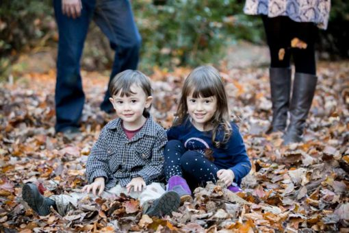 kids having fun with Autumn leaves
