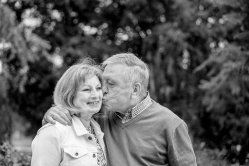 Pure love: elderly couple kissing and still in love
