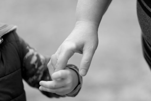 Detail of holding hands between a Mother and her Son. A very delicate and timeless shot.