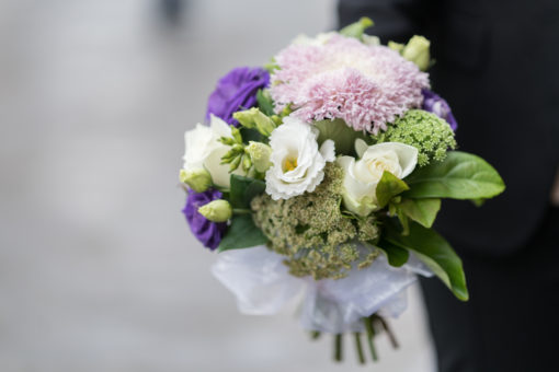bouquet of white, light pink and purple flowers for a beautiful bride