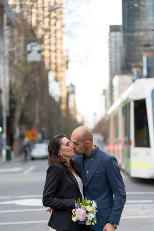 Newly married couple madly in love in Melbourne City. Natural laights and emotions by Erika's Way Photography
