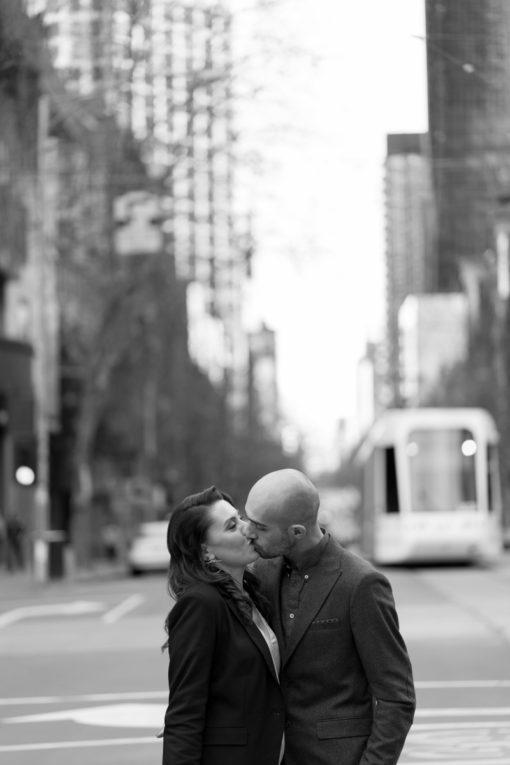 Couple in love kissing in Melbourne CBD