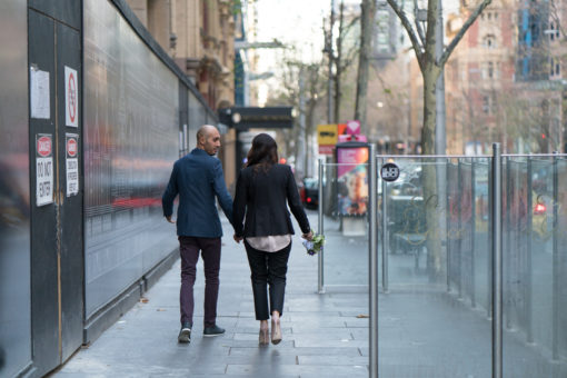 Husband and Wife walking along the streets in Melbourne, in Collins Street