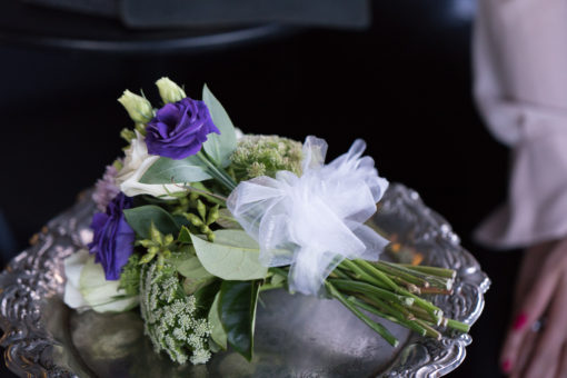 the bouquet with purple, cream white, green colour