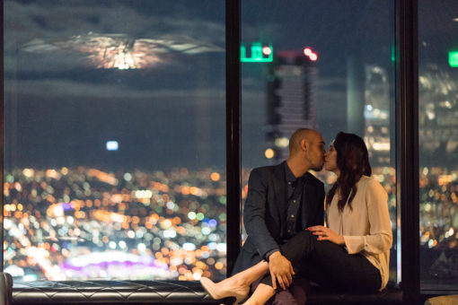 Husband and Wife kissing in the city night view