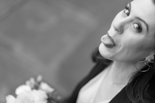 Bride showing her tongue to the camera