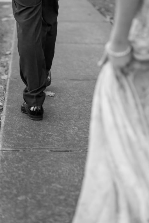 Detail of Husband and Wife's dresses walking
