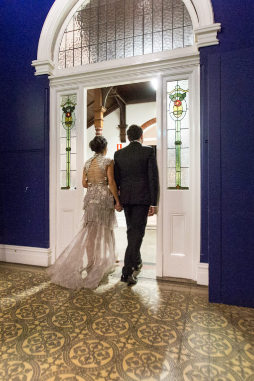 Husband and Wife walking down the aisle together hands and hands