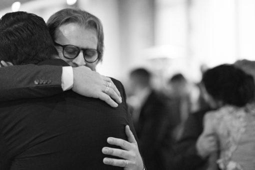 Father and son hug.