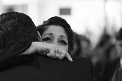 Mum of the Groom hugging her son just after the ceremony