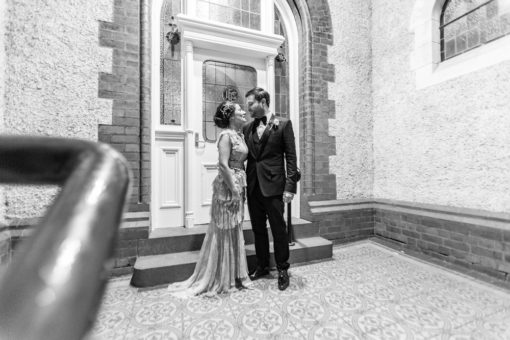 Husband and Wife looking at each others. Night Winter Wedding in Melbourne at Abbotsford Convent