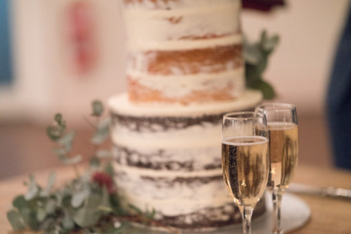 Two glasses of Champagne and the Wedding Cake