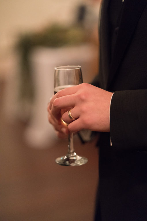 Detail of the Groom with a glass of Champagne